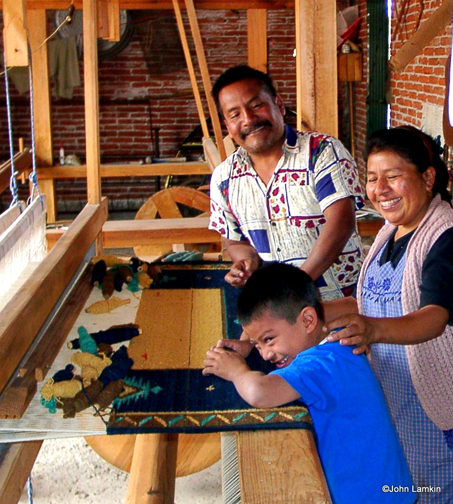 Juan Luis and family at the loom - weaving for Line of the Spirit™