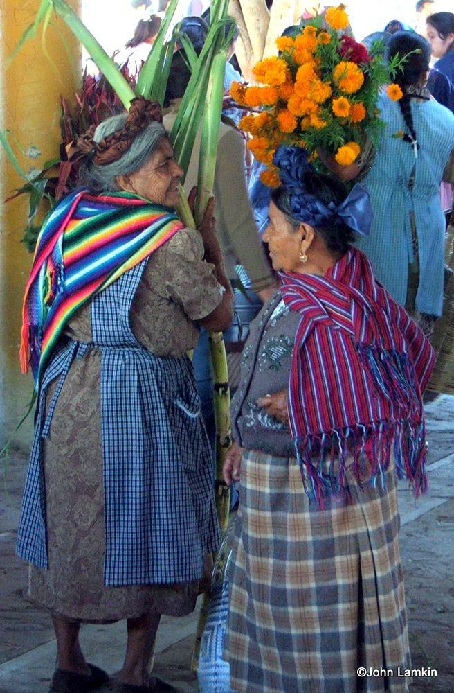Two women in village market, shopping for their #DayOfDead altars from upcoming book, INTERWOVEN LIVES..., by Susanna Starr, photos by John Lamkin.
