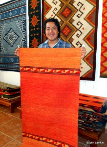 Diego Montaño and one of his rugs