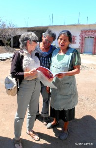 Susanna shows the book to Eliseo & Maria Bautista