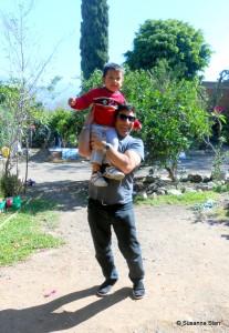 Roy holding Alta's grandson Pablito